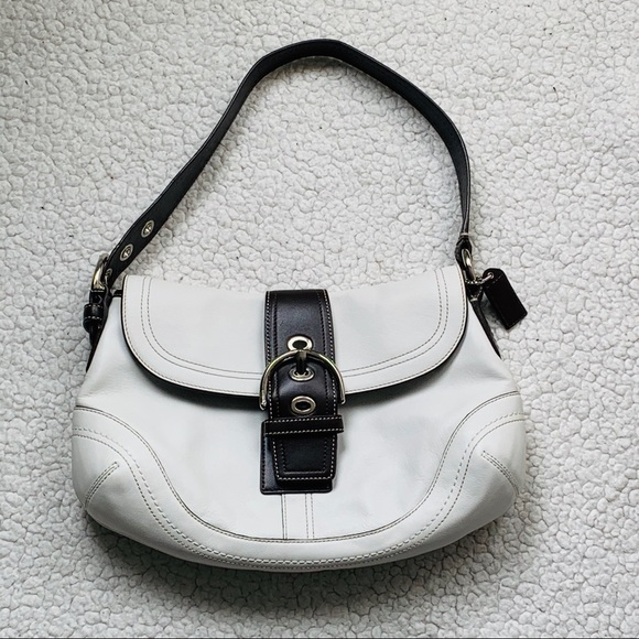Coach Handbags - Coach White Leather With Brown Trim Buckle Flap